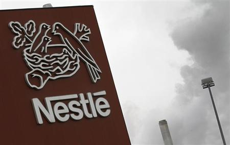 A Nestle logo is pictured on a factory in Orbe April 20, 2012. REUTERS/Joao Vieria
