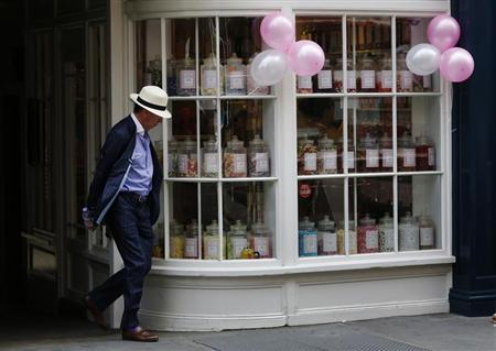 A man passes a traditional sweetshop in central London August 10, 2013. REUTERS/Luke MacGregor