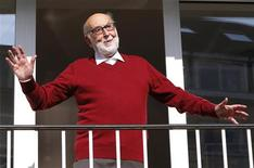 Belgian physicist Francois Englert reacts as he appears at the balcony of his house in Brussels October 8, 2013, after he and Britain's Peter Higgs won the 2013 Nobel prize for physics. REUTERS/Yves Herman