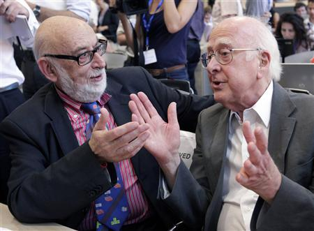 File picture of British physicist Peter Higgs (R) talking with Belgium physicist Francois Englert before a news conference on the search for the Higgs boson at the European Organization for Nuclear Research (CERN) in Meyrin near Geneva July 4, 2012. REUTERS/Denis Balibouse/Files