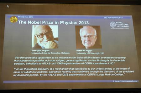 Images of Francois Englert of Belgium and Britain's Peter Higgs, laureates of the 2013 Nobel Prize in Physics, are displayed on a screen during a news conference at the Royal Swedish Academy of Sciences in Stockholm October 8, 2013. REUTERS/Erik Martensson/TT News Agency