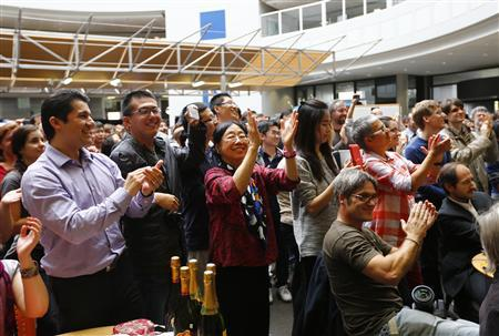 European Organization for Nuclear Research (CERN) staff celebrate after the announcement of the physics Nobel prize in Meyrin near Geneva October 8, 2013. REUTERS/Denis Balibouse