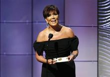 Television personality Kris Jenner presents the outstanding talk show host award during the 40th annual Daytime Emmy Awards in Beverly Hills, California June 16, 2013. REUTERS/Danny Moloshok