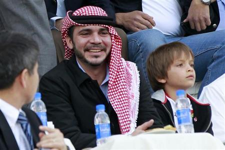 Jordan's Prince Ali bin Al-Hussein (C) and Prince Hashem (R), son of his brother King Abdullah, watch Jordan play against Japan during their 2014 World Cup qualifying soccer match at King Abdullah stadium in Amman March 26, 2013. REUTERS/Muhammad Hamed/Files