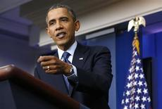 Президент США Барак Обама на пресс-конференции в Белом доме в Вашингтоне 8 октября 2013 года. Президент Барак Обама отказался во вторник идти на уступки Республиканской партии в споре о бюджете, заявив, что будет обсуждать бюджетные вопросы только после безоговорочного принятия федерального бюджета и повышения предела государственного долга. REUTERS/Kevin Lamarque