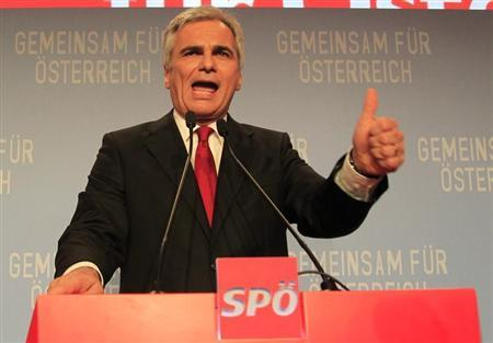 Austrian Chancellor and leader of the Social Democratic Party (SPOe) Werner Faymann addresses supporters after first projections in the Austrian general election in Vienna September 29, 2013. REUTERS/Petr Josek