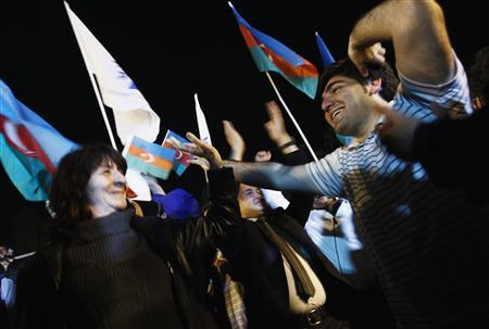 Supporters of Azerbaija's President Ilham Aliyev celebrate his victory on the presidential elections in Baku, October 9, 2013. REUTERS/David Mdzinarishvili