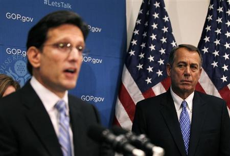 U.S. House Speaker John Boehner (R-OH) watches as House Majority Leader Eric Cantor (R-VA) addresses the press following a House Republican party meeting on Capitol Hill in Washington, October 8, 2013. REUTERS/Jason Reed