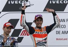 Honda MotoGP rider Marc Marquez (R) celebrates next to Yamaha MotoGP rider Jorge Lorenzo on the podium after winning the Aragon Motorcycling Grand Prix at the Motorland race track in Alcaniz September 29, 2013. REUTERS/Gustau Nacarino