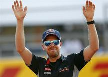 Red Bull Formula One driver Sebastian Vettel of Germany waves to fans at the Suzuka circuit October 10, 2013, ahead of Sunday's Japanese F1 Grand Prix. REUTERS/Toru Hanai