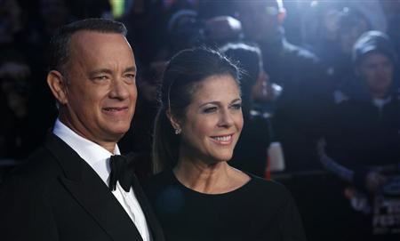 Actor Tom Hanks and his wife Rita Wilson arrive for the European premiere of ''Captain Phillips'', on the opening night of the London Film Festival, at the Odeon Leicester Square in central London October 9, 2013. REUTERS/Suzanne Plunkett