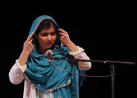 Pakistan's Malala Yousafzai adjusts her headscarf as she gives a speech after receiving the RAW (Reach All Women) in War Anna Politkovskaya Award at the Southbank Centre in London October 4, 2013. REUTERS/Luke MacGregor