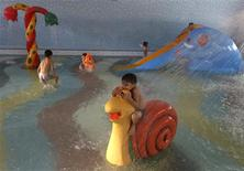Children play at a public swimming pool in Kabul October 4, 2013. REUTERS/Omar Sobhani