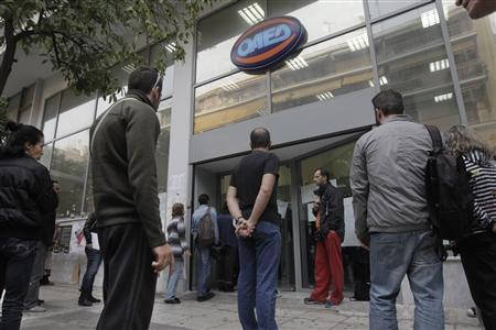 People wait for their turn outside a Greek Manpower Employment Organisation (OAED) office in an Athens suburb October 10, 2013. REUTERS/John Kolesidis