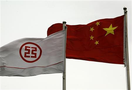 A flag printed with a logo of the Industrial & Commercial Bank of China (ICBC) flies alongside a Chinese flag outside a branch in China's southern city of Shenzhen in this March 25, 2010 file photo. REUTERS/Bobby Yip/Files