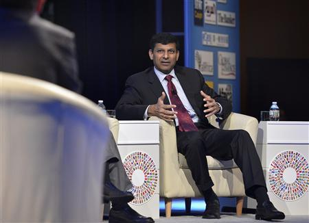 Reserve Bank of India Gov. Raghuram Rajan answers a question during a CNN Debate on the Global Economy, along with other bank governors and finance ministers, as part of the IMF and World Bank's 2013 Annual Fall Meetings, in Washington, October 10, 2013. REUTERS/Mike Theiler