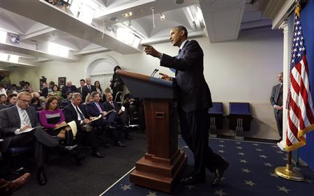 U.S. President Barack Obama holds a news conference about the federal government shutdown in the briefing room of the White House in Washington October 8, 2013. REUTERS/Kevin Lamarque