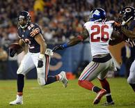 Oct 10, 2013; Chicago, IL, USA; Chicago Bears running back Matt Forte (22) rushes the ball against New York Giants strong safety Antrel Rolle (26) during the second half at Soldier Field. Mike DiNovo-USA TODAY Sports