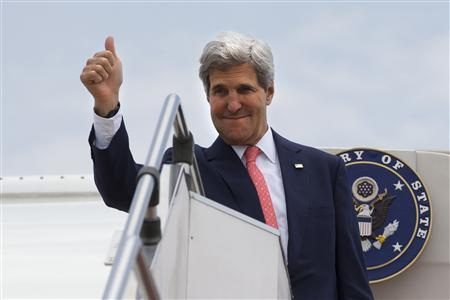 U.S. Secretary of State John Kerry makes the thumbs up sign as he leaves, after completing his trip to Malaysia, from Subang TUDM outside of Kuala Lumpur, October 11, 2013. REUTERS/Jacquelyn Martin/Pool