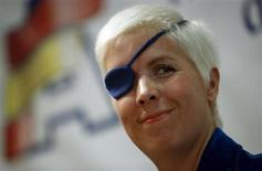 Marussia Formula One test driver Maria de Villota of Spain smiles during her news conference in Madrid October 11, 2012. REUTERS/Sergio Perez