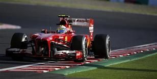 Ferrari Formula One driver Felipe Massa of Brazil drives during the second practice session of the Japanese F1 Grand Prix at the Suzuka circuit October 11, 2013. REUTERS/Issei Kato