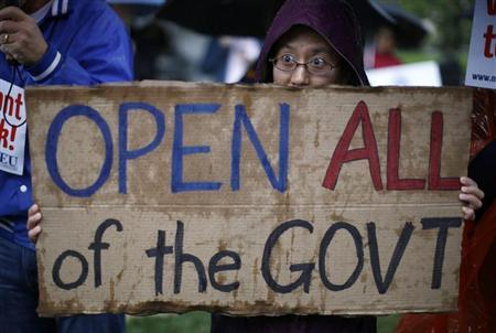 A protester giving only her first name as Nancy holds up a sign calling for an end to the U.S. government shutdown on Capitol Hill in Washington, October 10, 2013. REUTERS/Jason Reed