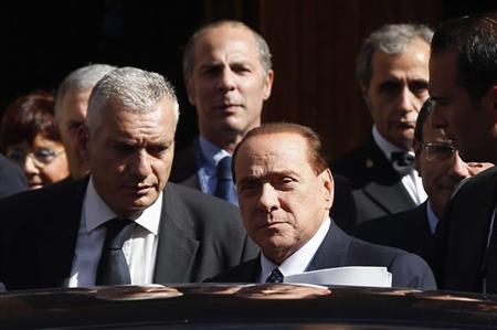 Italian center-right leader Silvio Berlusconi sits in hi car as he leaves the Senate in Rome, October 2, 2013. REUTERS/Remo Casilli