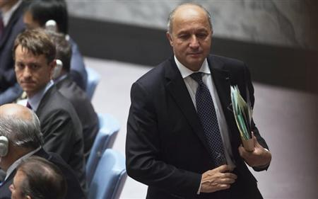 France's Minister of Foreign Affairs Laurent Fabius walks out during a Security Council meeting on small arms, during the 68th United Nations General Assembly at U.N. headquarters in New York, September 26, 2013. REUTERS/Carlo Allegri