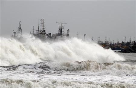 A big wave smashes into a breakwater at a fishing harbour in Jalaripeta in the Visakhapatnam district in Andhra Pradesh October 11, 2013. REUTERS/Stringer