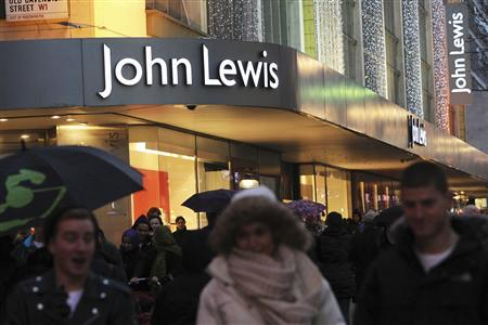 Shoppers pass in front of John Lewis department store in Oxford Street in central London, January 4, 2012. REUTERS/Finbarr O'Reilly