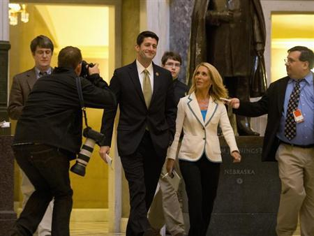 U.S. Representative Paul Ryan (C) walks with members of the media in Statuary Hall on Capitol Hill in Washington, October 11, 2013. REUTERS/Jason Reed