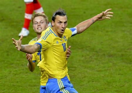 Sweden's Zlatan Ibrahimovic (front) celebrates with teammate Sebastian Larsson after scoring against Austria during their 2014 World Cup qualifying soccer match in Solna, Stockholm October 11, 2013. REUTERS/Jonas Ekstromer/TT News Agency
