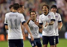 Oct 11, 2013; Kansas City, KS, USA; United States midfielder Graham Zusi (19) celebrates with his teammates after scoring against Jamaica during the second half at Sporting Park. Mandatory Credit: Peter G. Aiken-USA TODAY Sports