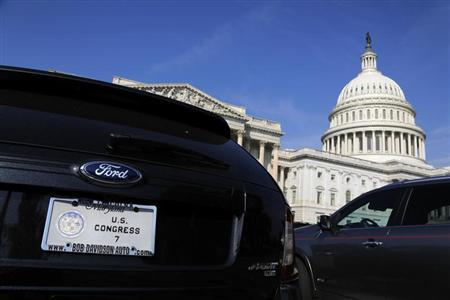 The cars of members of Congress, including one (L) belonging to a member of the Maryland delegation, fill the parking lot outside the House of Representatives during a Saturday session at the U.S. Capitol in Washington October 5, 2013. REUTERS/Jonathan Ernst
