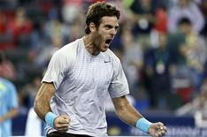 Juan Martin Del Potro of Argentina celebrates after winning the men's singles semi-final match against Rafael Nadal of Spain at the Shanghai Masters tennis tournament October 12, 2013. REUTERS/Aly Song