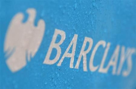 Raindrops are seen on the logo of a rental bicycle sponsored by Barclays in London July 30, 2013. REUTERS/Toby Melville