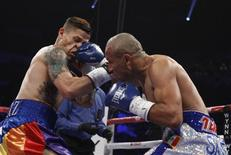 Featherweight boxer Orlando Cruz (L) of Puerto Rico takes a punch from Orlando Salido of Mexico during their title fight at the Thomas and Mack Center in Las Vegas, Nevada October 12, 2013. REUTERS/Steve Marcus (UNITED STATES - Tags: SPORT BOXING)