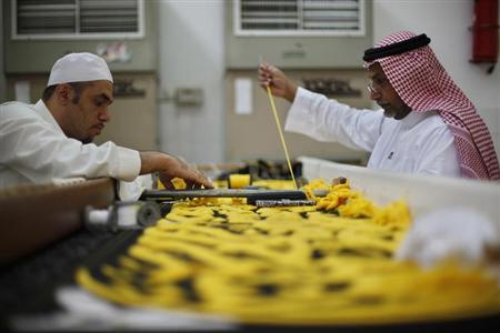 Workers embroider the Kiswa, a silk cloth covering the Holy Kaaba, in the holy city of Mecca, ahead of the annual haj pilgrimage October 8, 2013. REUTERS/Ibraheem Abu Mustafa