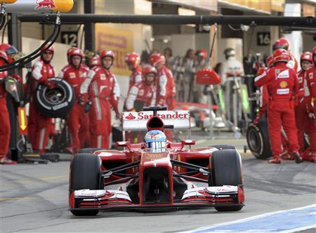 Ferrari Formula One driver Fernando Alonso of Spain leaves the pit during the Japanese F1 Grand Prix at the Suzuka circuit in Japan October 13, 2013. REUTERS/Toshifumi Kitamura/Pool