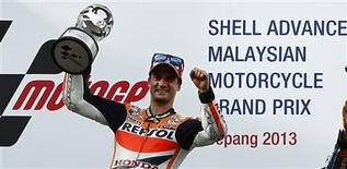 Honda MotoGP rider Dani Pedrosa of Spain celebrates after winning the Malaysian Motorcycle Grand Prix in Sepang October 13, 2013. REUTERS/Samsul Said