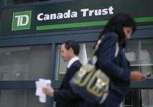 People walk past a Toronto Dominion Bank branch in Ottawa August 27, 2009. REUTERS/Chris Wattie