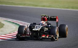 Lotus Formula One driver Romain Grosjean of France drives during the qualifying session of the Japanese F1 Grand Prix at the Suzuka circuit October 12, 2013. REUTERS/Issei Kato