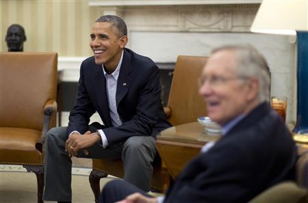 U.S. President Barack Obama meets U.S. Senate Democrats including Senate Majority Leader Harry Reid (D-NV) (R) in the Oval Office of the White House in Washington, October 12, 2013. REUTERS/Jason Reed