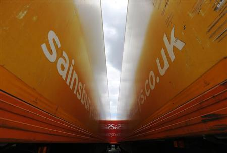 Sainsbury's supermarket trailers are seen parked at the new Sainsbury's distribution centre at Thameside in east London June 25, 2013. REUTERS/Luke MacGregor