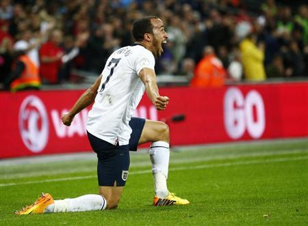 England's Andros Townsend celebrates scoring his team's third goal against Montenegro during their 2014 World Cup qualifying soccer match at Wembley Stadium in London, October 11, 2013. REUTERS/Darren Staples