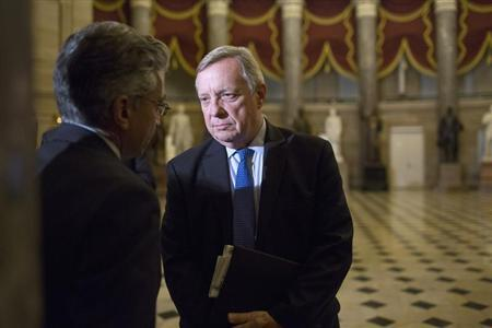 Nadeam Elshami, (L) chief of staff to House Minority Leader Nancy Pelosi (D-CA), speaks with U.S. Senator Dick Durbin (D-IL) after a late-night Senate vote rejected budget legislation from the Republican-controlled House of Representatives, at the U.S. Capitol in Washington, September 30, 2013. REUTERS/Joshua Roberts