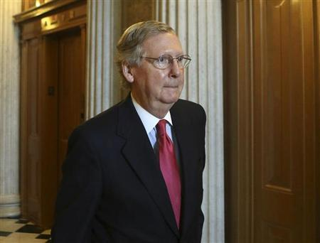 Senate Minority leader Senator Mitch McConnell (R-KY) walks to his party's working lunch on Capitol Hill in Washington October 8, 2013. REUTERS/Gary Cameron