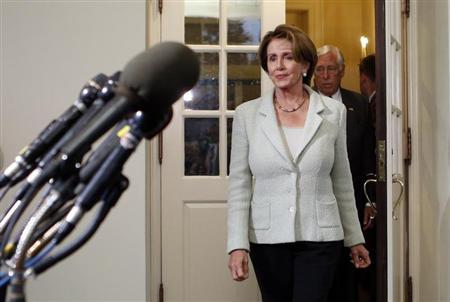 U.S. House Minority Leader Nancy Pelosi exits the White House to speak to reporters after a meeting between House of Representatives Democrats and U.S. President Barack Obama in Washington October 9, 2013. REUTERS/Kevin Lamarque