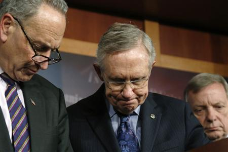 (L-R) U.S. Senator Charles Schumer (D-NY), Senate Majority Leader Harry Reid (D-NV), and Senator Richard Durbin (D-IL) attend a news conference at the U.S. Capitol in Washington, October 12, 2013. REUTERS/Jonathan Ernst