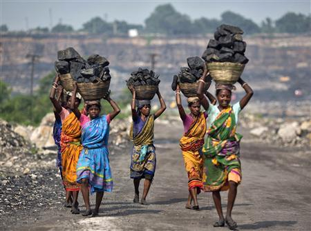 Local women carry coal taken from open cast coal field at Dhanbad district in the eastern Indian state of Jharkhand in this September 19, 2012 file photo. REUTERS/Ahmad Masood/Files